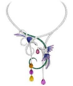 """Van Cleef & Arpels """"Birds of Paradise """" necklace featuring blue and purple Sapphires, Emeralds, mystery-set blue Sapphires and Diamonds set in 18k white, yellow and red Gold. Price upon request."""
