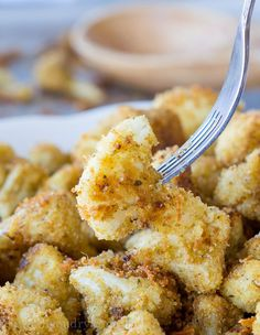 This whole Parmesan Roasted Cauliflower is a simple baked vegetable side dish recipe, which also doubles as a vegetarian chicken nugget!