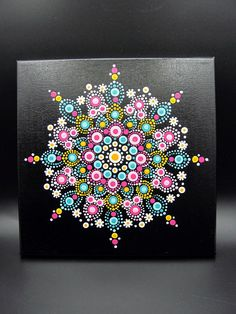 Beautiful hand painted dot mandala on canvas in shades of teal, pink, white and orange. This painting was painted with acrylic paints and finished with crystal clear acrylic gloss. The acid free canvas measures 10x10 inches and has a saw tooth hanger on the back. This is a hand painted item, meaning: the dots may be irregular, not uniform or off-center. This just adds to the character of a hand made piece. I hope you enjoy this piece as much as I enjoyed making it