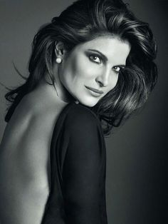 Stephanie Seymour wore a black open-back dress and pearl earrings for an Estée Lauder spring 2014 campaign.