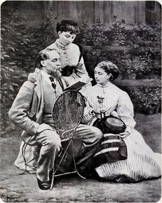 "Charles Dickens reading to his two daughters, ""Mamie"" and Kate (standing), at his Gad's Hill mansion, 1865."
