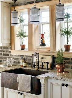 love the exposed brick backsplash and the farm house sink. I want exposed brick in my kitchen instead of tile.