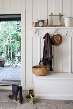 Simple Mudroom.  love the board and batten paneling