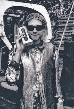 Kurt Cobain talking on an old school cell phone | Rare and beautiful celebrity photos
