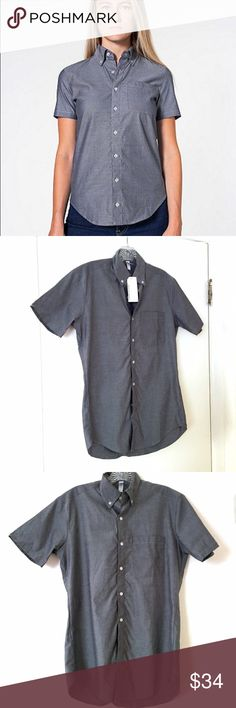 """American Apparel Chambray Short Sleeve Button-Down Brand new American Apparel Chambray Short Sleeve Button-Down with Pocket. The color is a grayish blue that is between the first and second photos. Size is unisex XS, which will fit a women's medium or an oversized small. Chest measures 20"""" across laying flat. 100% cotton. American Apparel Tops Button Down Shirts"""