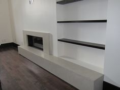 Foyer Ideas, Foyer Design, Wall Units, Fireplace Wall, Concrete Countertops, Fireplaces, Salons, Condo, Tables