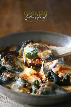 Chorizo Stuffed Poblano Peppers by Nutmeg Nanny - poblano peppers packed full of spicy chorizo, black beans, sweet corn, oaxaca cheese and baked in a flavorful tomato sauce.