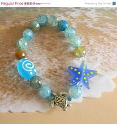 ON SALE Glass Starfish & Metal Turtle Stretch Bracelet with Assorted Beachy Blue Beads by ambiesbeadboutique on Etsy https://www.etsy.com/listing/238821334/on-sale-glass-starfish-metal-turtle