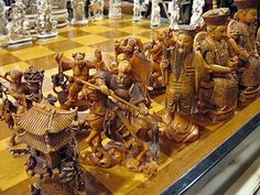 A splendid ivory chess set, carved around The pieces are in the form of Chinese classical figures, with the Emperor and Empress seated on thrones and measuring over seven inches in height. Wood Carving Patterns, Chess Pieces, Art Through The Ages, Board Games, Game Boards, Chess Sets, Wood Art, Chess Boards, Cool Stuff