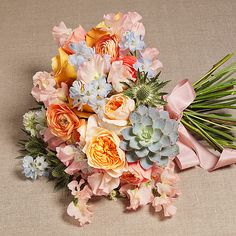 Brides.com: . Wedding Bouquet by Theme: Beach. A colorful beach bouquet of Juliet garden roses, sweet peas, succulents, thistles, ranunculus, and delphinium.  Browse more bouquets for a beach wedding.