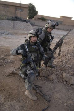 Army Rangers conduct a search of a weapons cache during combat operations in Iraq.