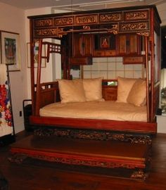chinese wedding bed, looks almost identical to mine.  so funny- growing up in a New Hampshire colonial farmhouse, this is NOT what most of our houseguests expected to sleep in!!