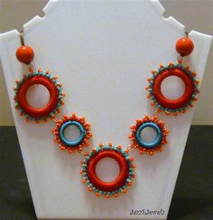 necklace. love!...these are SO much fun to make (plastic rings, embroidery or crochet threads,  beads)