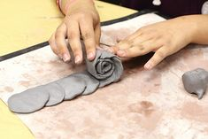 Roses - Make a caterpillar looking line descending from large to small circles and then roll up