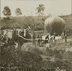 """Professor Thaddeus S. Lowe's military balloon near Gaines Mill, Virginia. The photo shows the inflation of the balloon """"Intrepid"""" from portable gas tanks with help from the Union … American Civil War, American History, Battle Of Cold Harbor, Virginia Camping, Civil War Art, Last Battle, Union Army, Air And Space Museum, Civil War Photos"""