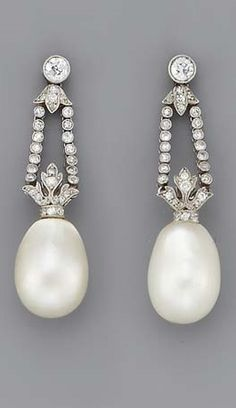 A PAIR OF BELLE EPOQUE PEARL AND DIAMOND EAR PENDANTS. Each composed of a pearl drop to the diamond twin line surmount, circa 1905, in original red leather fitted case embossed with initials P.A. for Philip Alexius de Laszlo (1869-1937). #BelleÉpoque #Earrings