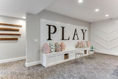 Salt Lake Parade of Homes Basement Daycare Ideas, Finished Basement Playroom, Playroom Bench, Basement Play Area, Playroom Ideas, Basement Remodeling, Garage Playroom, Playroom Decor, Play Rooms