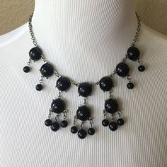 """Black Beaded Necklace Short necklace (20"""") that has adjustable chain. Silver chain and black beads. Goes great with a little black dress! I've worn the heck out of this necklace, but it still has lots of life left! Charming Charlie Jewelry Necklaces"""