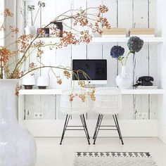 All-white home office idea. Maximize your floorplan by just having an office wall computer station. Whitewashed wide wood planks make this a lovely office area perfect for a rustic style home.