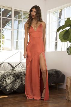 Sleek body skimming maxi dress with a plunging v-neckline and thigh high split at front skirt. Lace up straps at back bodice. Invisible zipper closure at back skirt. What To Wear To A Wedding, How To Wear, Bodice, Neckline, Thigh Highs, Spring Summer Fashion, Thighs, Lace Up, Formal Dresses