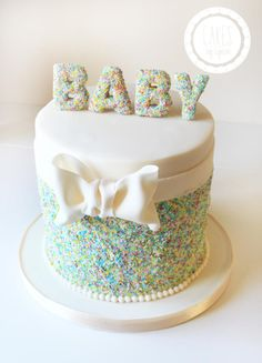 My take on a sprinkles cake for a baby shower. Coloured white sprinkles to get the desired colours. :)