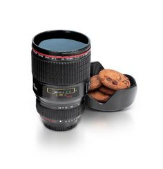 KJB Security Camera Lens Cup by KJB Security. $14.99. Perfect for photographers. Snacks holder. Looks like a realistic camera lens. Fancy yourself as bit of a photographer, love snapping up those memorable moments or super model glamour shots? Well you can now feel like a photo fanatic with this brilliantly quirky new mug which looks exactly like a real camera lens and will soon become an essential part of your photographer?s kit bag!! Styled to look and feel l...
