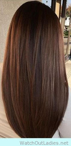 Sultry brown hair color with subtle warm highlights