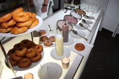 At the doughnut station, guests could top freshly baked plain doughnuts with white or milk chocolate sauce, powdered sugar, chopped nuts, or colored sprinkles.