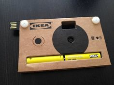 "IKEA's cardboard digital camera. Included as part of a press kit at an event in Europe recently, this ""disposable"" cam might go on sale sometime soon in IKEA stores. Uses two AA batteries & stores up to 40 photos in the built-in memory. Images can be downloaded to your computer using the USB connection that swings out from one of the corners of the camera."