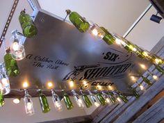 Wine-bottle chandelier at Six Shooter Cellars near Fredericksburg