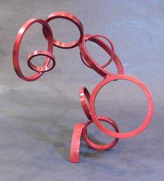 Abstract metal ring sculpture yard art or interior art