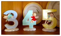 Three sweet little Norcrest 'Happy Birthday' cake toppers.  The holes for the candles are on the top of each figurine.