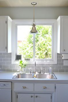 white cabinets, grey subway tile