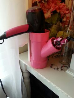 Hairdryer & straightener holder. PVC pipe from lowes $3.99 & spray paint.