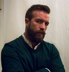 """It didn't take long for his life to change. A couple of months into his newfound beard-dom, this picture made it to the front page of Reddit. """"You look like a mix of Arnold Schwarzenegger and Ben Affleck,"""" one commenter said."""