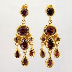 Garnet Chandelier Earrings set in Sterling Silver with a Gold Overlay. $110