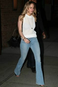 Jennifer Lawrence wearing Theory Mayleen Sleeveless Open Knit Sweater, Diane von Furstenberg Disco Bucket Bag, Gianvito Rossi Halter-Strap Sandals and Isabel Marant Gold Spike Pendant Leon Necklace