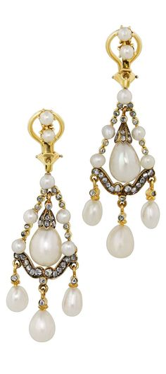 A pair of Victorian silver, gold, diamond and natural pearl earrings, circa 1850. #Victorian #antique