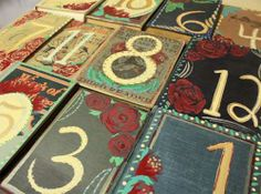Hand painted vintage books for table numbers...Lots of funky wedding ideas on this site.