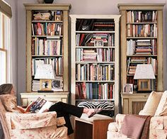 Three tall book cases with living room furniture