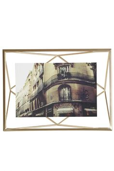 """Add new dimension to your photo displays with this prismatic 4x6"""" brass wire frame in which a photo floats between two panes of glass. Can alternately sit on the desk or be hung on the wall.  Prisma Frame Brass 4x6 by Umbra. Home & Gifts - Home Decor - Frames Canada"""