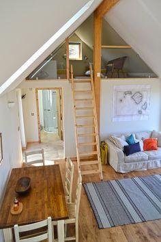 Mezzanine bedroom, accessible by fold away ladder.  Bathroom & double bedroom beyond.