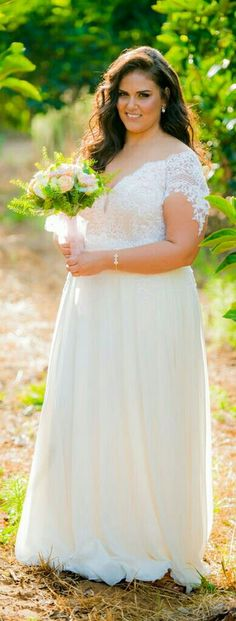 Real plus size bride in a boho plus size wedding gown from Studio Levana