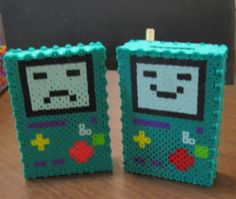 Hey, I found this really awesome Etsy listing at https://www.etsy.com/uk/listing/242060538/perler-bmo-adventure-time-coin-bank