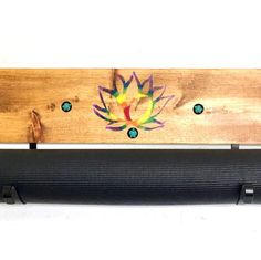 NEW! Handpainted with turtle ornamentation for your groovy yogi. Chakra painted lotus on a walnut brown stained, real wood board. Large brackets to hold your #yogamat. Wall mountable and beautiful. Buy yourself  or a friend a great gift. #yoga #yogaroom #groovymom #groovydad #yogagifts #sfetsy #handmadeyoga #wanderlustgifts #homeyoga #yogahome #YogaWaresyogahooks #yogawares #yogalove #hippiedecor #chakradecor #chakragifts #MothersDayyoga