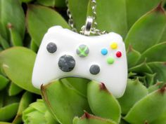 Mini Xbox 360 Controller Necklace by NerdyLittleSecrets on Etsy from NerdyLittleSecrets on Etsy. Saved to Jewelry. Xbox 360 Controller, Clay Mugs, Kawaii Accessories, Cute Necklace, Clay Charms, Cool Gadgets, Disney, Polymer Clay, Geek Stuff
