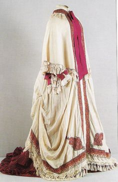 1880 Maria Feodorovna's cloak and dress.  The dress barely shows beneath the cloak with a cape-like upper part worn by Maria Feodorovna in 1880.