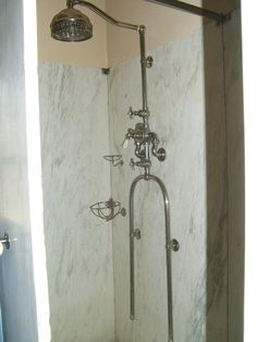 1918 ?marble shower encloosure with Hajoca shower valve with u shaped body spray
