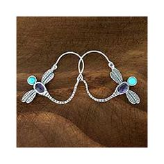 @Overstock.com - Sterling Silver 'Dragonfly' Amethyst Hoop Earrings (Mexico) - Mexican dragonflies arc gracefully to form novel hoop earrings. Francisco Sanchez adorns each sterling silver earring with cool amethyst and natural turquoise.  http://www.overstock.com/Worldstock-Fair-Trade/Sterling-Silver-Dragonfly-Amethyst-Hoop-Earrings-Mexico/5544338/product.html?CID=214117 $47.69