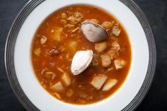 Manhattan Clam Chowder ~ A Manhattan style clam chowder in a tomato-based sauce with potatoes, onions, carrots, celery, and a little bacon. ~ SimplyRecipes.com